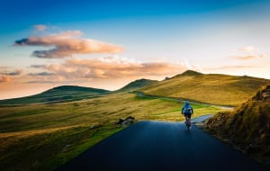 rear view of man on mountain on road